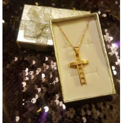 croix dorée en relief